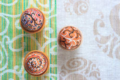 Handmade colorful painted easter egg against matching tablecloth Royalty Free Stock Photos