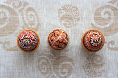 Handmade colorful painted easter egg against matching tablecloth Royalty Free Stock Images