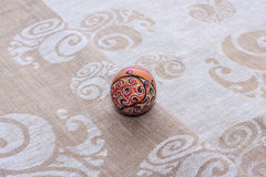 Handmade colorful painted easter egg against matching tablecloth Stock Photography