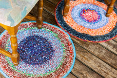 Handmade colorful rugs on a wooden floor Royalty Free Stock Image