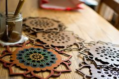 Handmade colorful wooden mandalas royalty free stock photography