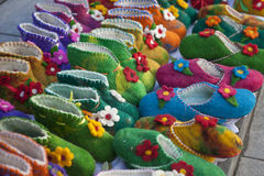 Handmade colorful wool slippers or shoes for sale at street in Tbilisi, Georgia, Europe. Royalty Free Stock Photos