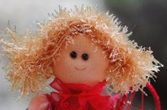 Handmade coloured doll Stock Photos