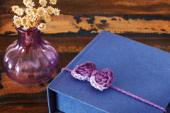 Handmade colourful crochet bow for gift packadge with vase Royalty Free Stock Images