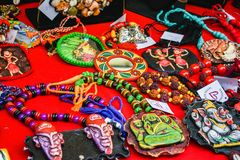 Handmade colourful Indian bead jewelries being laid on a table for sale. stock images