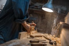 Handmade concept. Workshop on wood. Women`s hands create. A product made of wood royalty free stock images