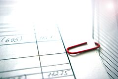 Handmade copy, red clip . Brightly lit by highlighting, working on a document. Brightly lit by highlighting royalty free stock photography