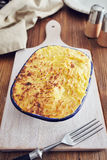 Handmade cottage pie. Traditional british handmade cottage pie in a country style Stock Photos