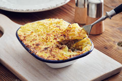 Handmade cottage pie. Traditional british handmade cottage pie in a country style Royalty Free Stock Photos
