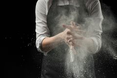 handmade cotton chef with mold flour on a black background royalty free stock image