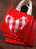 Heart on gift bags Stock Photos