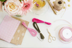 Handmade, craft concept. Materials for making string bracelets and handmade goods packaging - twine, ribbons. Feminine workplace c stock image