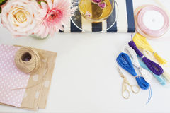 Handmade, craft concept. Materials for making string bracelets and handmade goods packaging - twine, ribbons. Feminine workplace c stock photo