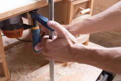 Handmade and craft furniture concept Carpenter engaged in processing wood in his workshop. Man hands working in furniture wood stock images
