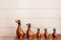 Handmade vintage  carved wood duck model for home decoration on. Handmade craft vintage carved wood duck model for home decoration on retro wooden box Stock Image