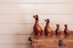 Handmade vintage  carved wood duck model for home decoration on. Handmade craft vintage carved wood duck model for home decoration on retro wooden box Stock Photos
