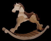 Craftsman's Rocking Horse on Black Background Stock Images