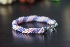 Handmade crochet beaded bracelet from beads of pink and lilac color Royalty Free Stock Photos