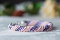 Handmade crochet beaded bracelet on textile background Stock Image