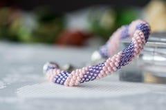 Handmade crochet beaded bracelet on textile background Stock Photo