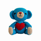 Handmade crochet blue bear doll stock photo
