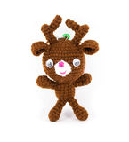 Handmade crochet brown deer doll on white background Stock Image
