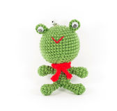 Handmade crochet green frog doll on white background Royalty Free Stock Photography