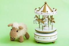 Handmade Crochet Lamb Toy on Green Background. Stock Photo