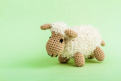 Handmade Crochet Lamb Toy on Green Background. Royalty Free Stock Images