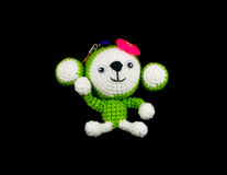 Handmade crochet monkey doll on black background Royalty Free Stock Photo