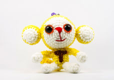 Handmade crochet monkey doll on white background Stock Photos