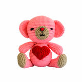 Handmade crochet pink bear doll Royalty Free Stock Images