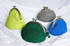 Handmade crochet purse with cotton thread in green, silver, blue Stock Images