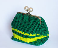 Handmade crochet purse with cotton thread in green and yellow co Stock Photo