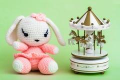 Handmade Crochet Rabbit Toy on Green Background. Stock Photos