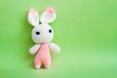 Handmade Crochet Rabbit Toy on Green Background. Royalty Free Stock Photos