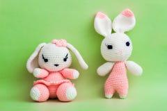Handmade Crochet Rabbit Toys on Green Background. Stock Images