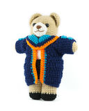 Handmade crochet teddy bear doll with graduation gown on white b Stock Images