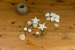 Handmade crochet white-beige beads pendant natural seashel Stock Photography
