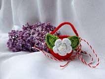 Handmade crocheted basket with red and white string, known as Martisor. Handmade crocheted basket with red and white string, known as Martisor, it is a Romanian stock photos