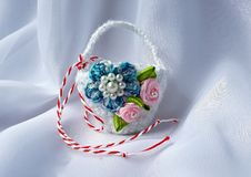 Handmade crocheted basket with red and white string, known as Martisor. Handmade crocheted basket with red and white string, known as Martisor, it is a Romanian stock image