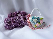 Handmade crocheted basket with red and white string, known as Martisor. Handmade crocheted basket with red and white string, known as Martisor, it is a Romanian stock images
