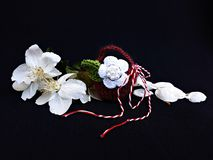 Handmade crocheted basket with spring flowers and red and white string, known as Martisor. Handmade crocheted basket with spring flowers and red and white stock photo