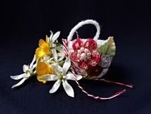 Handmade crocheted basket with spring flowers and red and white string, known as Martisor. Handmade crocheted basket with spring flowers and red and white royalty free stock photography