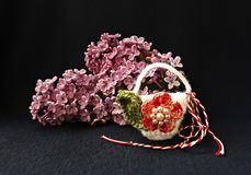 Handmade crocheted basket with spring flowers and red and white string, known as Martisor. Handmade crocheted basket with spring flowers and red and white royalty free stock photos