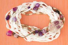 Handmade crocheted cotton lace wreath. White crochet frame pattern, handicraft background, needlework creative craft. Bright croch Stock Photos