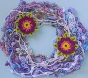 Handmade crocheted cotton organic lace wreath. Bright crochet frame pattern, handicraft background, needlework creative craft. Cro royalty free stock image