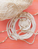 Handmade crocheted cotton organic lace wreath. White knitted frame, pattern, handicraft background, needlework creative craft. Ten Royalty Free Stock Photography