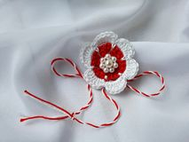 Handmade crocheted flower with red and white string, known as Martisor. Handmade crocheted flower with red and white string, known as Martisor, it is a Romanian royalty free stock images