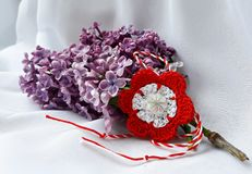 Handmade crocheted flower with red and white string, known as Martisor. Handmade crocheted flower with red and white string, known as Martisor, it is a Romanian royalty free stock photos